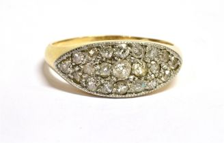 A DIAMOND PAVE SET BOAT HEAD 18CT GOLD RING The boat shaped front pave set in platinum with a