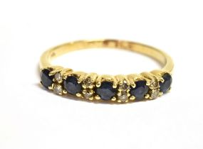 A SAPPHIRE AND DIAMOND HALF ETERNITY RING Five small sapphires alternating with pairs of small