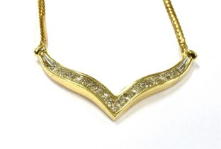 A 14KT DIAMOND SET NECKLACE Marked, ITALY 14KT, the central V set with 15 small single cut