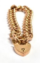 A ROSE GOLD CURB LINK BRACELET Fitted with a gilt metal heart padlock clasp and gilt metal