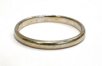 AN 18CT WHITE GOLD WEDDING BAND with rubbed hallmarks, possibly London 1966, maker E & G, size R,