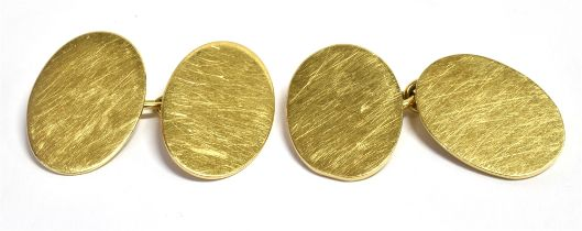 A PAIR OF 9CT GOLD OVAL CUFFLINKS Measuring approx. 1.7 cm by 1.2 cm Hallmarked for London 1989