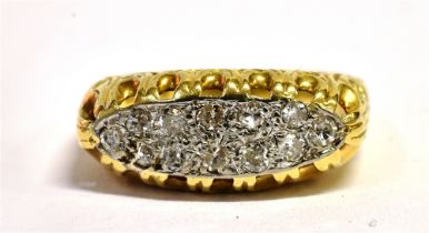 AN 18CT GOLD DIAMOND BOAT RING With the platinum head set with 12 small single cut diamonds, the