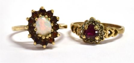 A 9CT GOLD RUBY SET RING With the central ruby shaped as a heart and the ring shoulders of open work