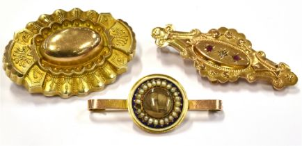 MEMORIAL BROOCHES three late 19th century to early 20th century brooches comprising a small 9ct gold
