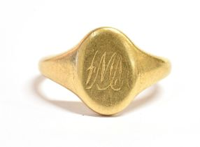 A 18ct GOLD SIGNET RING with a monogrammed initial cartouche, hallmarked for Birmingham with faded