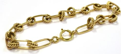 A YELLOW METAL BRACELET Of open work design, unmarked with testing indicating 14Kt, 17.5 cm long,
