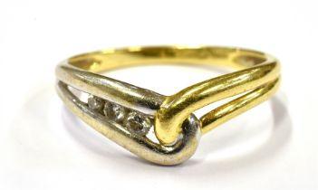 A DIAMOND SET WISHBONE RING On yellow metal with white metal detail, shank marked 18kt, ring size