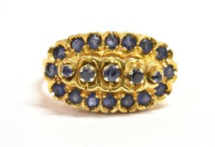 AN 18CT GOLD SAPPHIRE CLUSTER RING The boat shaped cluster head set with 21 small sapphires with the