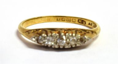 AN 18CT GOLD DIAMOND AND PLATINUM BOAT RING The five small graduated old cut diamonds set in a bed