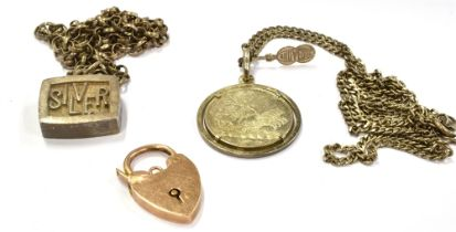 A SILVER ½ OZ INGOT PENDANT On a chain with faded markings to clasp, together with a silver