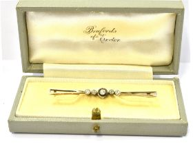 AN OLD CUT DIAMOND FIVE STONE BAR BROOCH The central diamond measuring 3mm in diameter and flanked