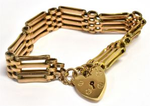 A 9CT GOLD FOUR GATE BRACELET With heart padlock, weight approx. 16 grams