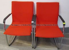 Two matching red upholstered audience chairs from the Press Conference Room at Liverpool Football