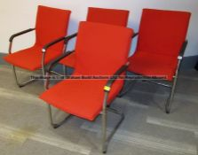 Four red upholstered audience chairs from the Press Conference Room at Liverpool Football Club's