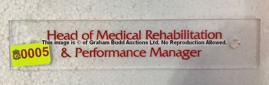 Clear acrylic HEAD OF MEDICAL REHABILITATION & PERFORMANCE MANAGER door sign from the Captains'