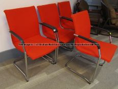 Four matching red upholstered audience chairs from the Press Conference Room at Liverpool Football