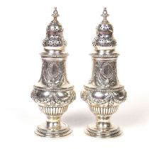 A pair of Victorian sugar casters
