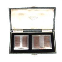 An Art Deco parcel gilt silver compact set