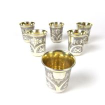 A Russian set of six silver gilt beakers