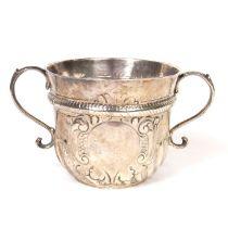 A George I Britannia silver twin handled porringer, early 18th century