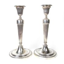 A George III pair of early Sheffield solid silver candlesticks, 18th century