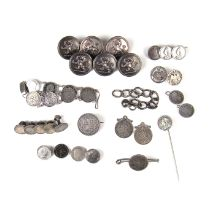 Collection of coin set items along with six livery buttons.