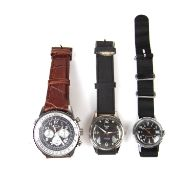 Collection of three watches.