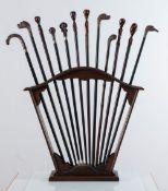 Lotto di dodici bastoni in legno e metallo argentato con porta-bastoni, fine XIX – inizio XX