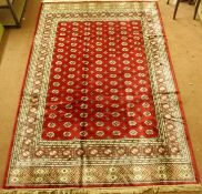 A Kashmir rug with a red ground Bokhara design, 300cm x 197cm Condition Report: Available upon