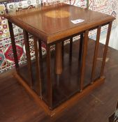 A miniature mahogany revolving bookcase (def) Condition Report: Available upon request