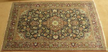 A blue ground Sarough rug with red central medallion and border, 214cm x 132cm Condition Report:
