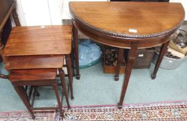 A mahogany nest of tables and a small demi-lune fold over card table (2) Condition Report: