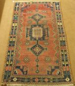 A red ground Eastern rug with geometric design, 230cm x 128cm Condition Report: Available upon