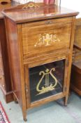 An inlaid rosewood music cabinet, 109cm high x 57cm wide x 36cm deep Condition Report: