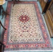 A cream ground Keshan rug with red central medallion and border, 208cm x 132cm Condition Report: