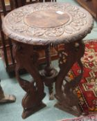 A carved hardwood oriental occasional table, 60cm high x 46cm diameter Condition Report: Available