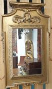 A gilt framed pier mirror, 105cm high x 65cm wide Condition Report: Available upon request