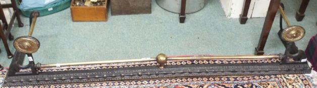 A cast iron and brass fender, inset, 133cm wide x 26cm Condition Report: Available upon request