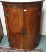 A Georgian mahogany bow front hanging corner cabinet, 105cm high x 75cm wide Condition Report: