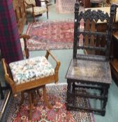 An inlaid rosewood adjustable piano stool and a carved oak hall chair (2) Condition Report: