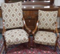 An inlaid mahogany open armchair with upholstered back and seat, 113cm high with a matching ladies
