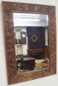 A carved oak wall mirror, 82cm x 59cm Condition Report: Available upon request