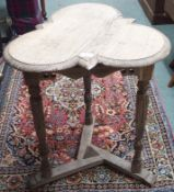 *An oak trefoil occasional table, 66cm high Condition Report: