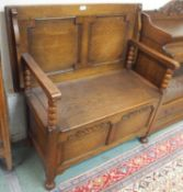 A small oak monks bench with panel front and back, 93cm high x 92cm wide x 46cm deep Condition