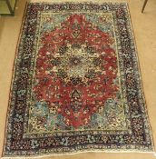 A deep pink ground Tabriz rug with central medallion and a main blue border, 275cm x 200cm Condition
