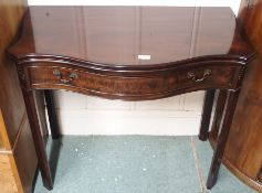 A reproduction mahogany serpentine front tea table with single drawer, 73cm high x 87cm wide