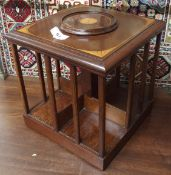 An inlaid mahogany revolving table top bookstand, 28cm high Condition Report: Available upon