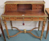 A reproduction writing desk with gilt gallery and three frieze drawers, 96cm high x 94cm wide x 46cm