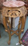 A gilt plant stand with carved frieze and pink marble top, 92cm high Condition Report: Available